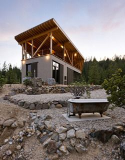 Modern cabin and cheeky tub located in the stark terrain for Sierra nevada cabine