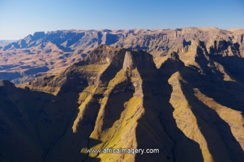 Cathedral Peak with Cathkin Peak and Monks Cown in background. Ukhahlamba Drakensberg Park. KwaZulu Natal. South Africa
