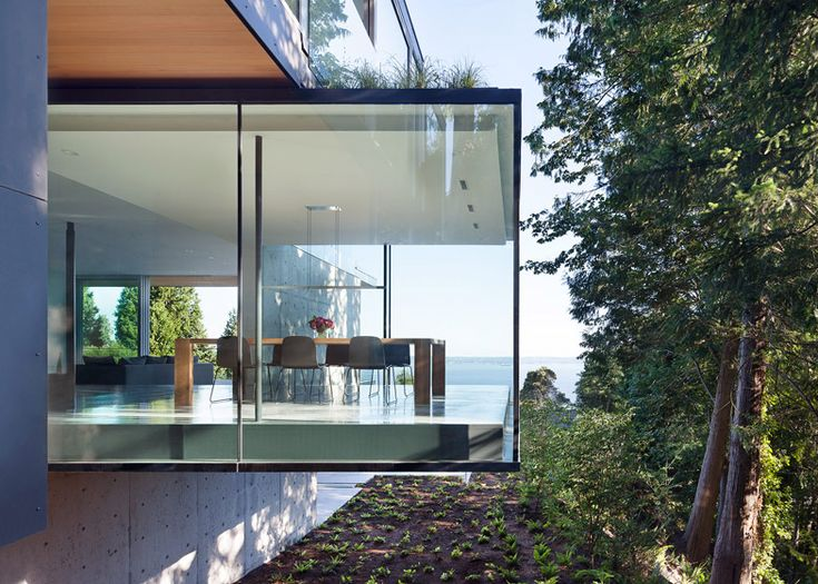 Protruding glass boxes offer ocean views from Russet Residence in Vancouver by Splyce Design