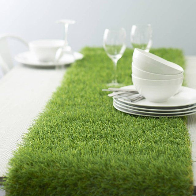 """Artificial Grass Table Runner on a light blue or pink table. House shaped flower pots with """"clouds"""" in them."""