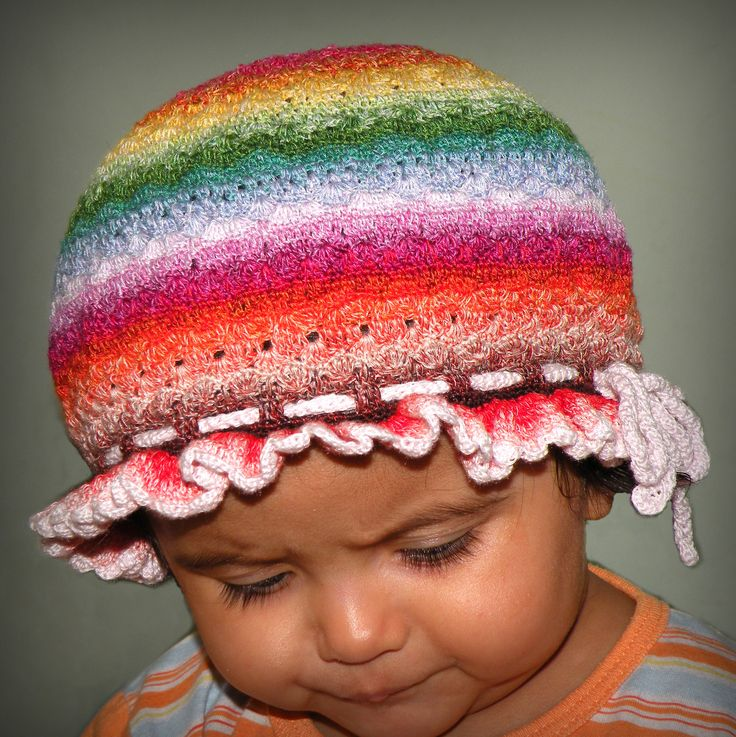A colorful crocheted baby cap