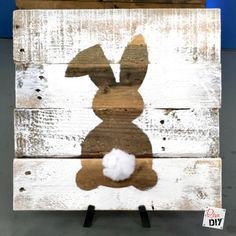 Rustic reclaimed wood signs are all the rage! Using pallet wood for the sign makes these signs a cheap and easy DIY to add to your Easter Decorations.: