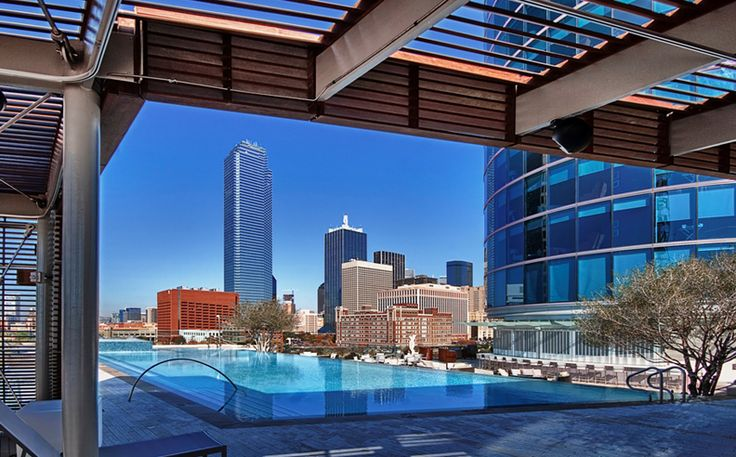 Omni Dallas Hotel Pool under the #Dallas skyline... TIP: be in the pool at sunset when the hotel lights come on!