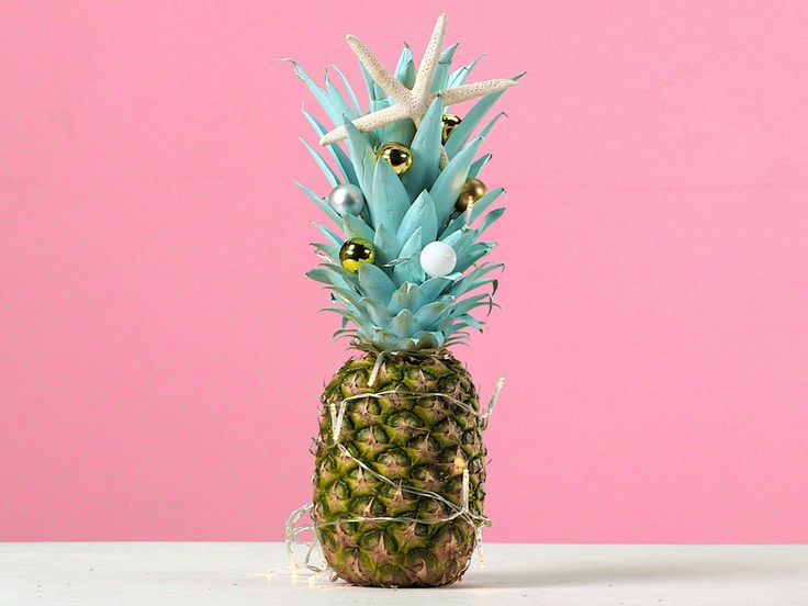 3 Beachy Ways to Decorate Your Christmas Pineapple (It's This Year's Tropical Holiday Trend!)   This hot holiday trend is taking Instagram by storm—here, three easy ways to decorate these delicious fruits for your end-of-year celebration.