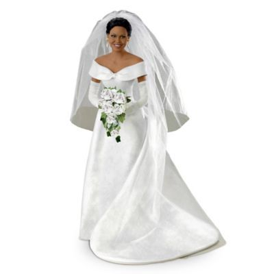 16-inch handcrafted bisque porcelain poseable bride doll commemorates Michelle Obama's wedding day. Authentically styled gown and replica jewelry.