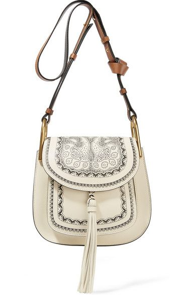 EXCLUSIVE AT NET-A-PORTER.COM. Chloé's cream and black bag is updated with an intricate hot-stamped bandana pattern at the front - a key print in this capsule. It features all the iconic details we've come to love from the 'Hudson' family - gold hardware, a knotted strap and sizable tassel. The spacious suede-lined interior has three compartments to keep your cell phone, wallet and keys organized.