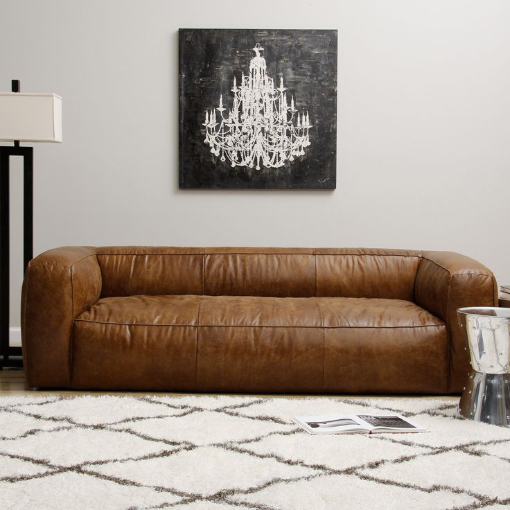 This puffy contemporary sofa is composed of full Italian leather with a lovely distressed finish. The comfortable piece contains a soft assortment of polyurethane foam, duck feathers and polyester fiber within the upholstery.