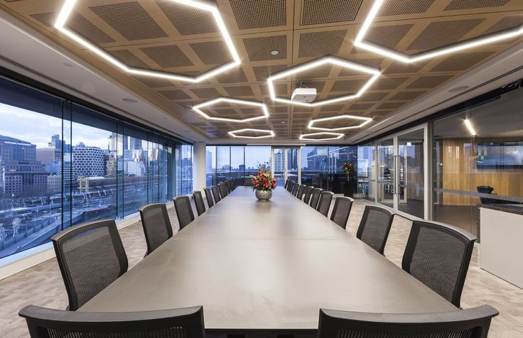 Custom perforated acoustic ceiling panels and feature lighting