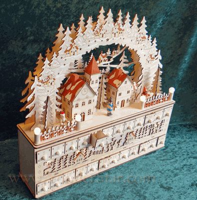 """A """"halo"""" of intricately carved trees tops the winter village, while a lighted silhouette winter scene nestles between the numbered drawers - this is a """"MUST HAVE"""" for discerning collectors!"""