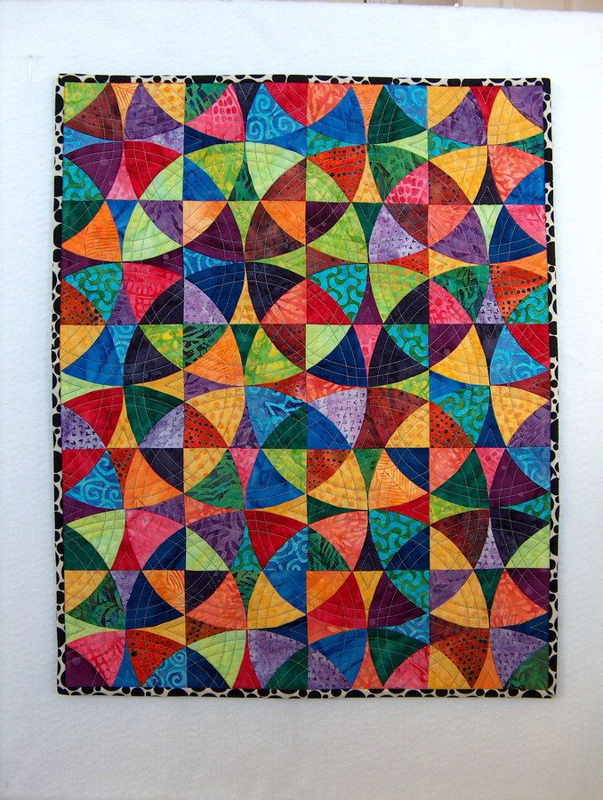 The quilt is called 'Kaleidoscope' but it uses a 'Winding Ways' pattern and not the traditional Kaleidoscope pattern.