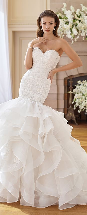 Strapless organza trumpet gown with sweetheart neckline, hand-beaded lace bodice with dropped waist, back covered button closures, multi-layered ruffled skirt accented with beaded lace appliqués and horsehair trim, chapel length train, detachable spaghetti and halter straps included.