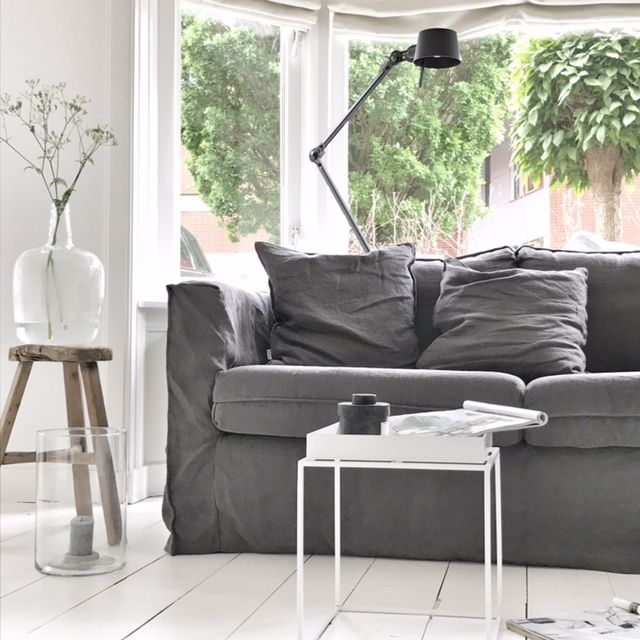 Anja Willemson's stunning minimal Scandinavian inspired living room | white washed wooden floors | minimalist coffee table | grey linen sofa | IKEA Karlstad sofa with a Bemz Loose Fit Urban cover in Medium Grey Rosendal Linen