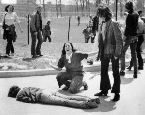 1970: Ohio National Guardsmen open fire on Kent State University students protesting the widening of the war on May 4; four are killed. John Filo's Pulitzer Prize-winning photograph of Mary Ann Vecchio, a 14-year-old runaway, kneeling in anguish over the body of Jeffrey Miller minutes after he was shot by the Ohio National Guard.