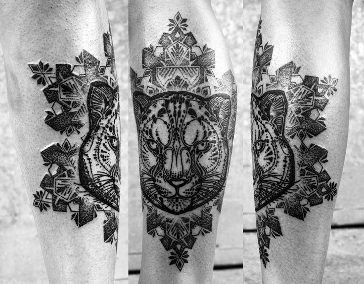 A tattoo of a puma by David Hale with spiritual mandala patterns