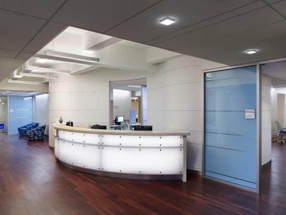 Patients are visually drawn to the softly lit reception which welcomes them to the Practice.