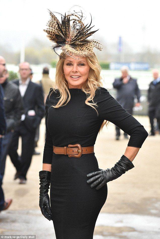 Top bird: Caroline Vorderman certainly lead the glamour atThe Cheltenham Festival on Thursday in a fitting black dress