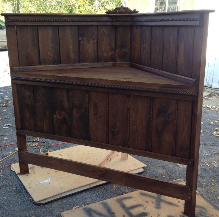 Stained walnut, before painted soft white and distressed. Corner queen headboard that I built.