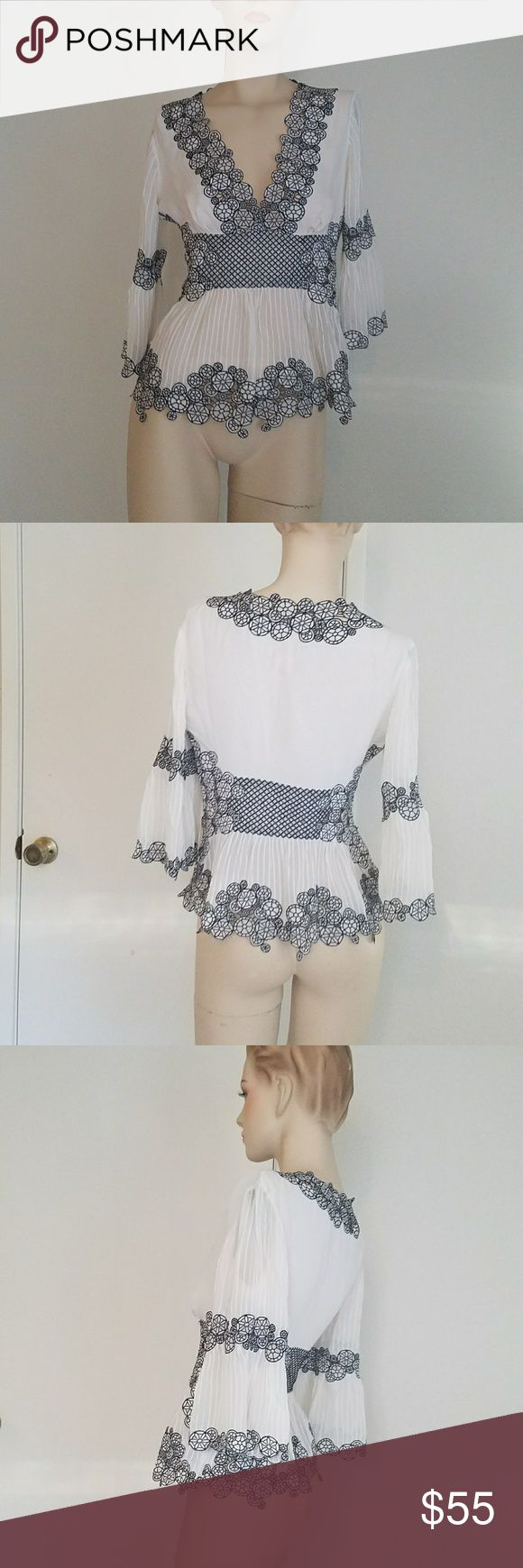Catherine malandrino embroided Top sz 6 Like new sz 6 but it runs small so i will list as size 4.  Tag for exposure: bebe bcbg Anthropologie Gucci versace, antonio melani, valentino, free people, luxxel Catherine Malandrino Tops Blouses