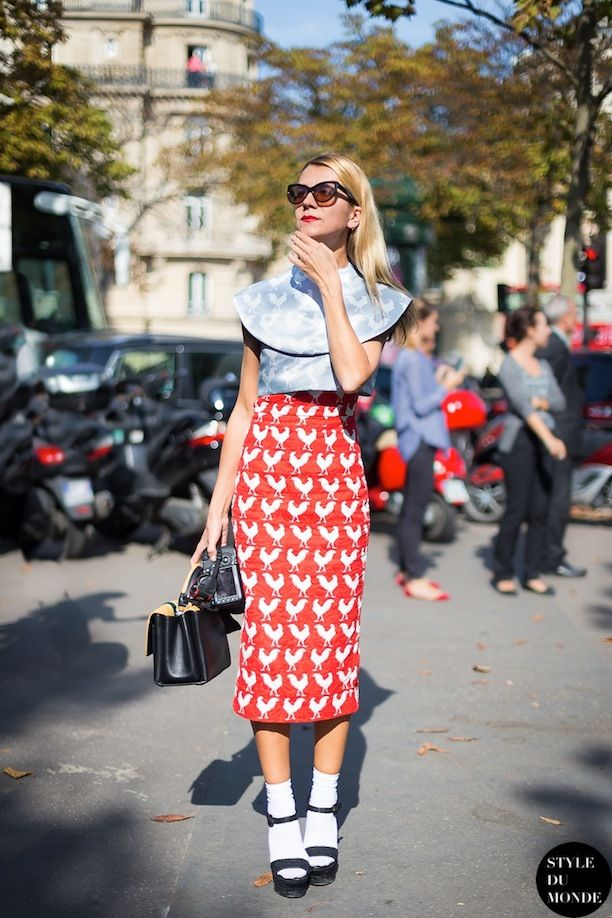 Natalie Joos in a red/white rooster skirt and heels with socks