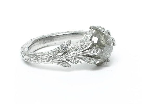 A beautifully included grey diamond, set in a diamond and platinum leaf ring, by Cathy Waterman.