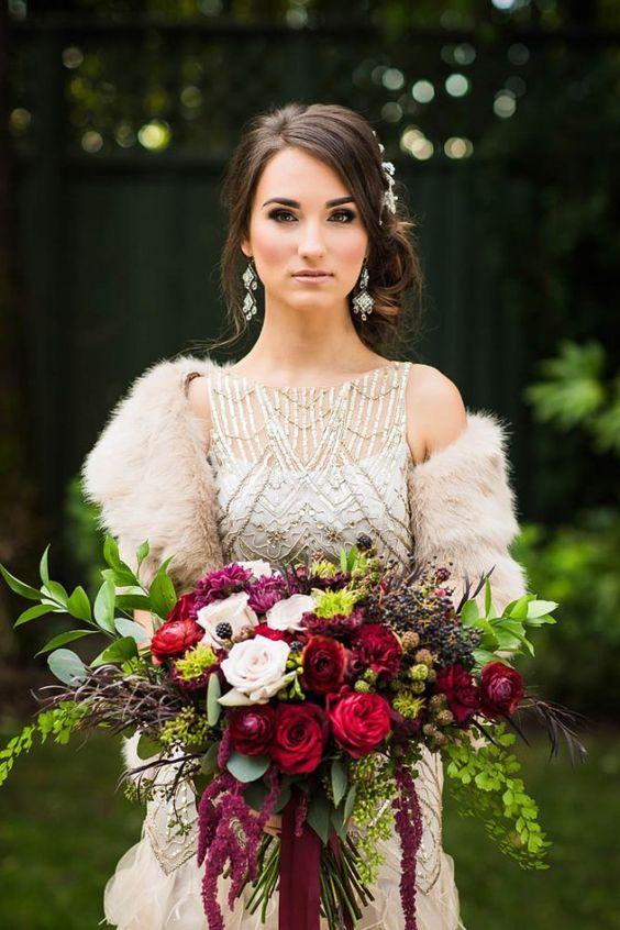 Berry-toned overgrown bouquet and faux fur bridal wrap / http://www.deerpearlflowers.com/faux-fur-winter-wedding-ideas/