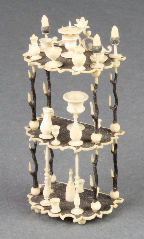 "LOT 745, A Victorian miniature turned and stained bone 3 tier what-not with vessels 3 1/2"" SOLD £260"