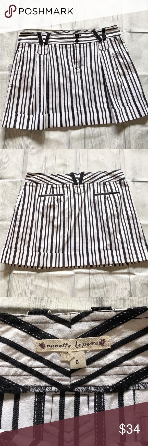 """Nanette Lepore Black and White Mini Skirt Black and white skirt has a zip front with two buttons. Diagonal front pockets and belt loops complete the look. Measures 17""""inches across the top and 15.5""""inches long Dry Clean Nanette Lepore Skirts Mini"""