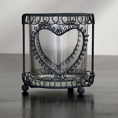 I would grab 6 or 8 of these and place different colour candles in each, and place grouped together on my side tables.