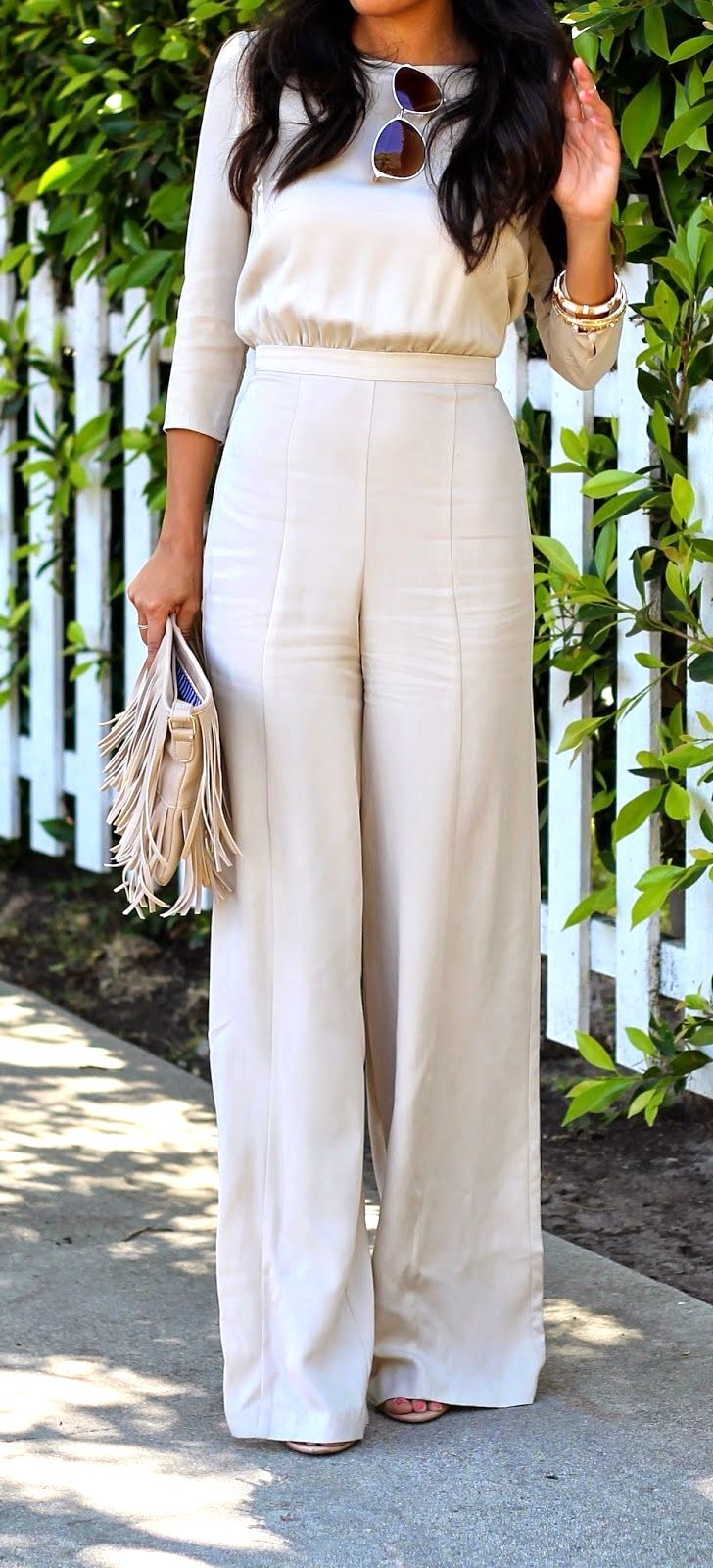 How to wear a long-sleeve jumpsuit chic enough to attend a day Spring or Summer wedding.