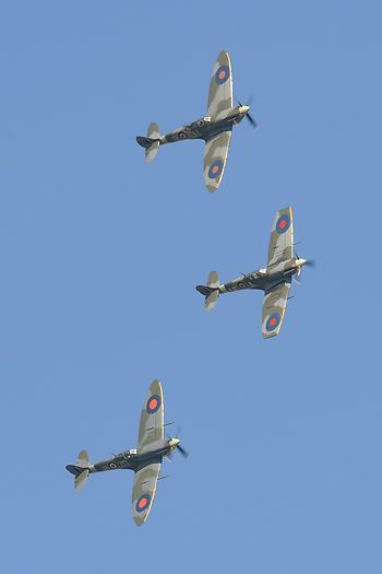 Clipped-wing Spitfire VB AE-A leads a 3-ship formation at the Duxford Jubilee Airshow.