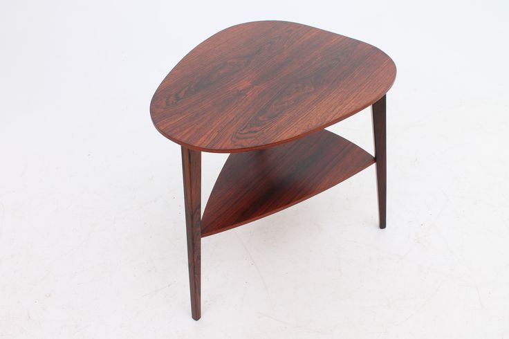 Small organic shaped side table in rosewood. Designed and manufactured in Denmark in the 1960s. www.reModern.dk