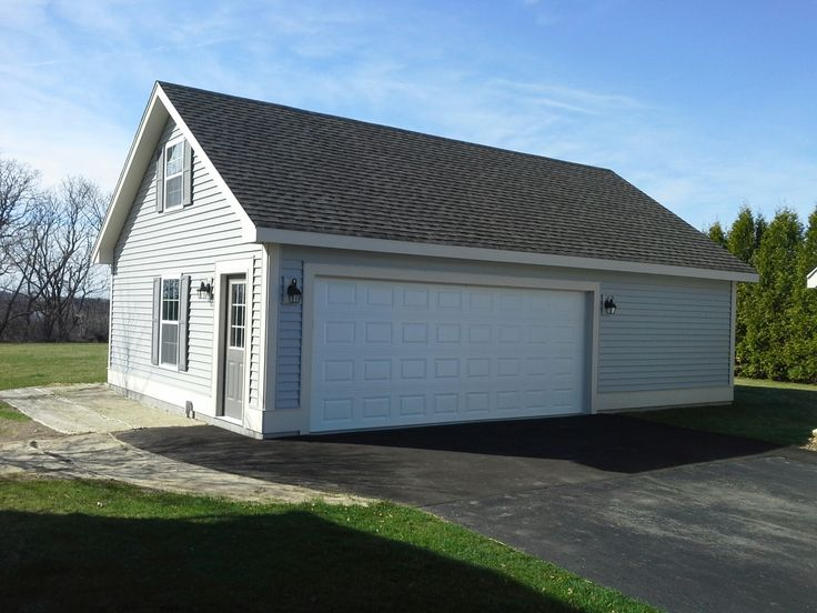 Great looking garage built with some extra room upstairs for Garages with upstairs living space