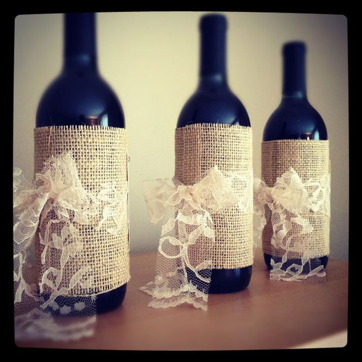 wine bottles wrapped in burlap & a lace bow...could put baby's breath in them