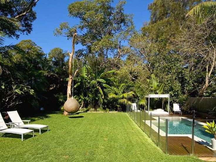 geometric pool design using grass with pool fence outdoor furniture setting pool photo 459713