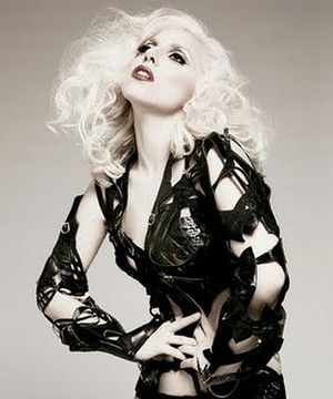 Gaga in the famous 'couture hunch' pose.