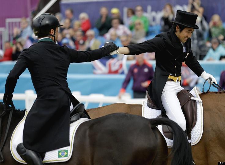 Yoshiaki Oiwa (Japan) is congratulated by Ruy Fonseca  (Brazil) Individual Dressage