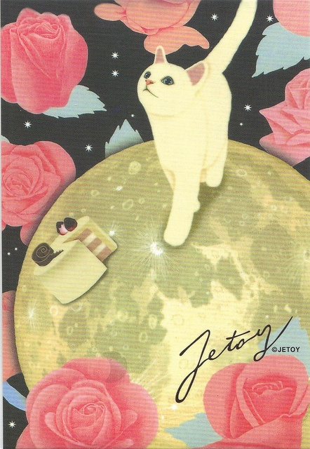 Jetoy cat on a moon with a cake.