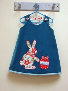 EASY PATTERN --- Girls and Toddler Reversible Dress Pattern. The Petal Dress is a simple easy to make A line dress with two reversible faces so you can flip it over and have a completely different dress. Features a bright little flower or Easter Bunny applique on one side --- this is optional, you can make the dress without the applique if you prefer. You can have fun combining fabrics and trims to create your own uniquely beautiful little dress. The dress is suitable for babies, toddlers…