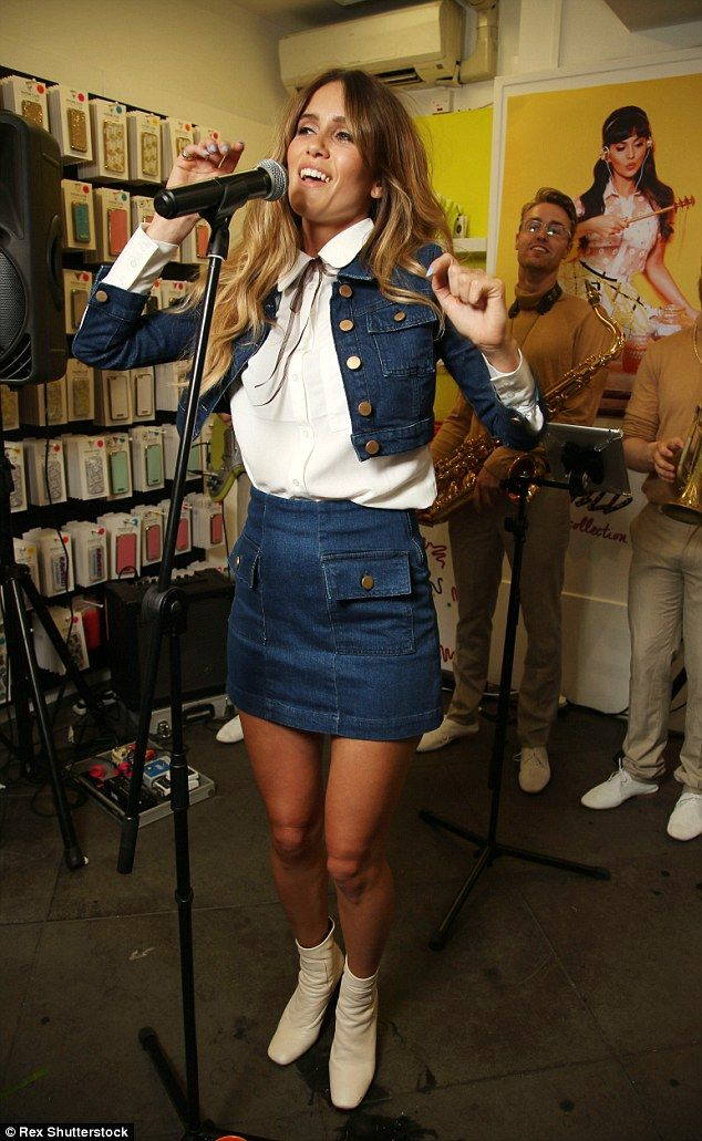 Taking to the mic: Singer Jade gave a low-key performance at the venue in her cowboy chic ...