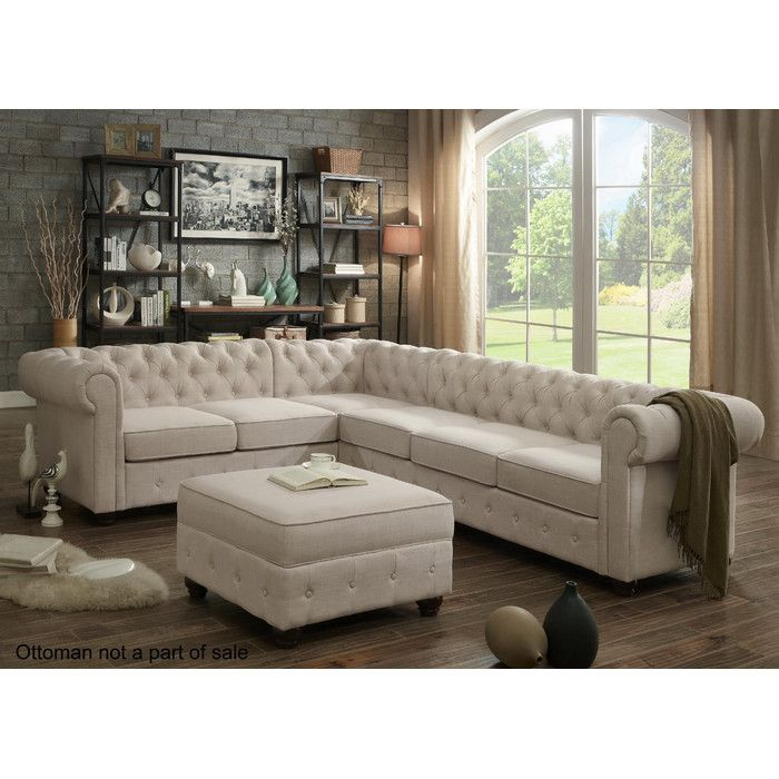 Stylist's Tip: There's a reason the Chesterfield is such a style icon, and this chic sofa is no exception to the rule. Its rolled arms invite lounging with a book or curling up with a mug of tea, while its decadent button tufting and linen upholstery have a crisp and classic feel that's at home in handsome spaces and timeless abodes alike.