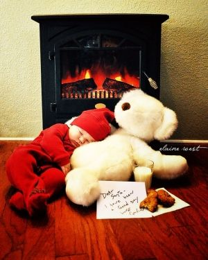 Or perhaps in front of/under the Christmas tree... And also chewing the bear's face off instead of sleeping hahaha