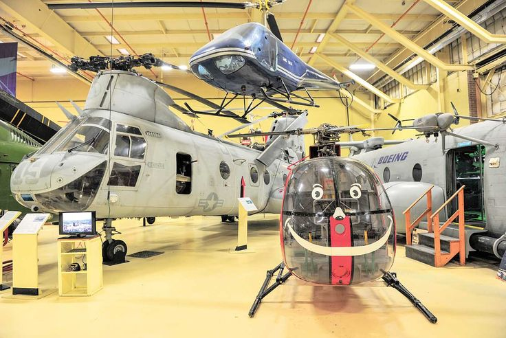 "Another classic tandem at the museum in the U.S. Marine Corps.' Boeing Vertol CH-46E ""Phrog."" Hanging from the roof is an Enstrom F-28. Skip Robinson"