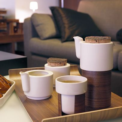 WARM is a tea and coffee set that combines ceramic teacups and teapots with bracelets of laminated bent wood. Held on by friction the wood acts as handles and helps insulate your tea or coffee. Since its launch in 1998 WARM tea and coffee set has become a 'mini classic' of Finnish and Scandinavian design