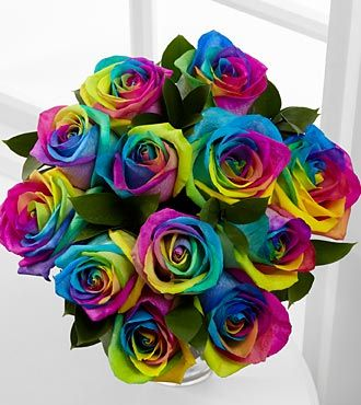 The Time to Celebrate Rainbow Rose Bouquet is a burst of vibrant color that adds that extra special touch to any special occasion! These kaleidoscope inspired roses have been dyed so that each petal displays a different vibrant hue of either yellow, blue, green, purple or pink to create a unique bouquet that turns any celebration into an extraordinary time. A perfect gift for birthdays!