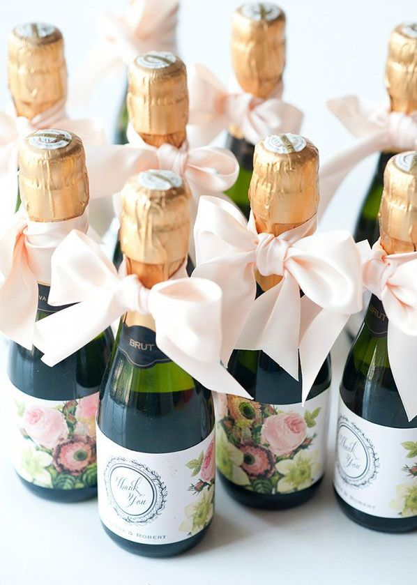 Mini Champagne wedding favors with floral labels