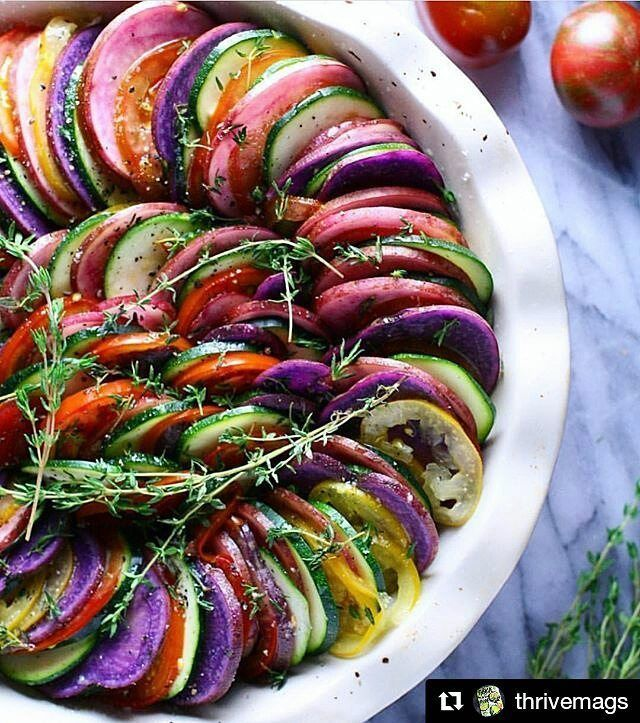 Yes, yum. This rainbow ratatouille all day #Repost @thrivemags (@get_repost) ・・・ Amazing vegan tian with zucchini, heirloom tomatoes, pink and purple potatoes, caramelized onion, thyme and garlic. Photo by Nancy @urbankitchenapothecary #tian #heirloomtomatoes #purplepotatoes - - - #vegan #veganfood #potatoes #rainbowfood #eattherainbow #veggies #vegetables #chef #ratatouille #ratatouilles #bakedveggies #grilledveggies #bestofvegan #onions #garlic #thyme #zucchini #frenchcuisine #eaty...