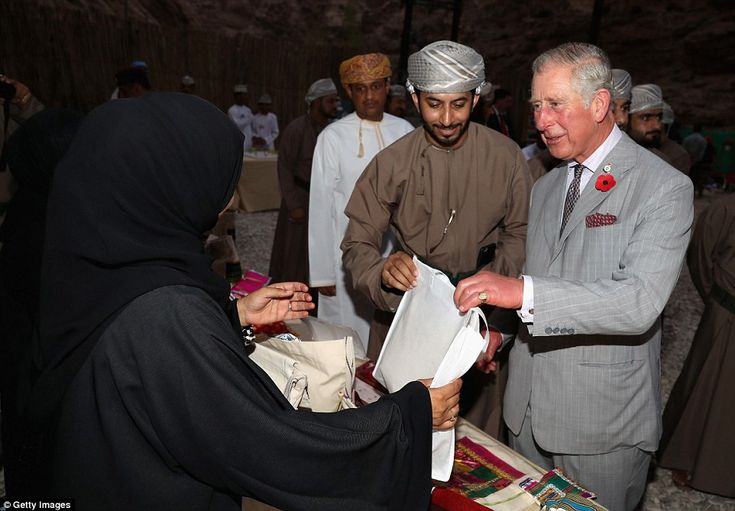 Charles speaks to a local trader as part of hisvisit to Ras Al Shajar. He and Camilla hav...