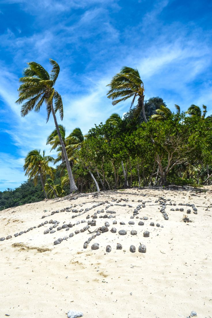 """Modriki Island, Fiji - This island in the Mamanuca chain was the set for the Tom Hanks movie Cast Away. Today, the coconut """"Help Me"""" is the only thing that still remains from the movie set"""