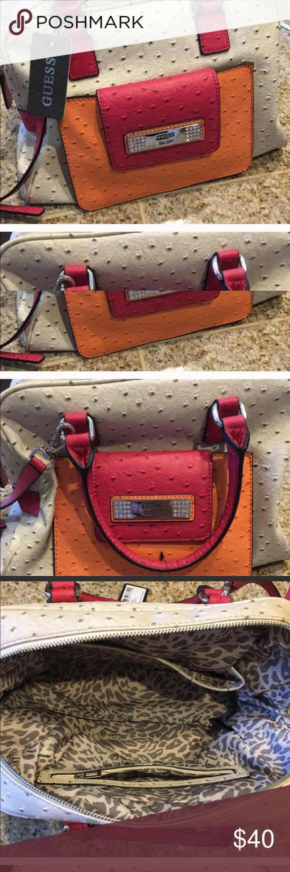 Guess Color Block Purse (Tag still on) Beautiful, color block purse from Guess. Medium/large sized bag with the tag still on. I repeat::Never once used! Leopard interior/lining. It was a Graduation gift, I still consider keeping it but it's not exactly my style. Get it before I change my mind!!! Guess Bags