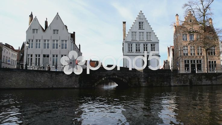 Near water level. View of a bridge and houses in Bruges, Belgium - Stock Footage | by glenman77